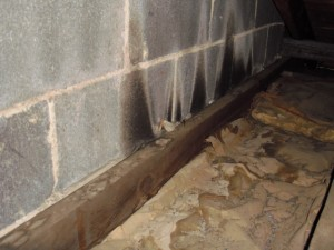 Air can enter the attic from gaps between masonry walls and interior walls